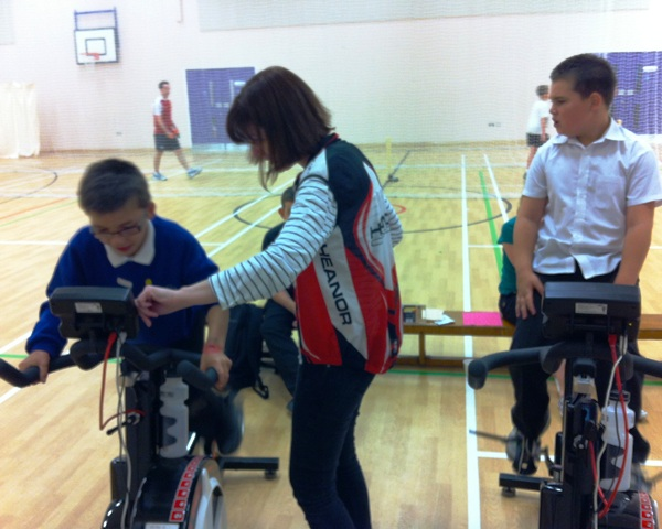 Aldercar School youngsters playing on the Wattbikes